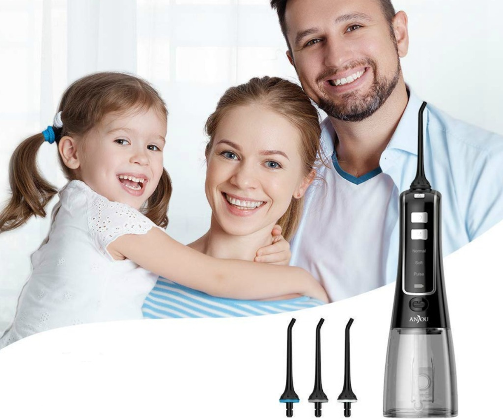 a whole family with a water flosser