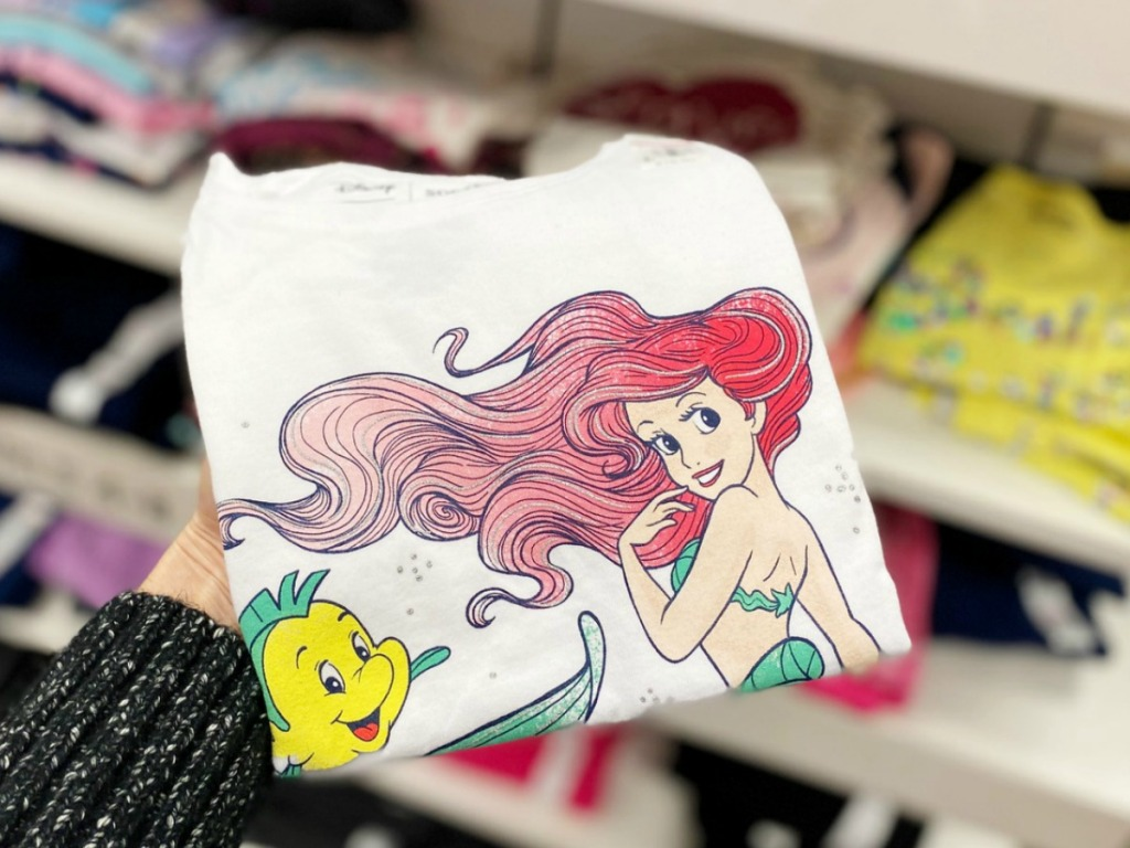 Disney themed girls graphic tee folded in hand
