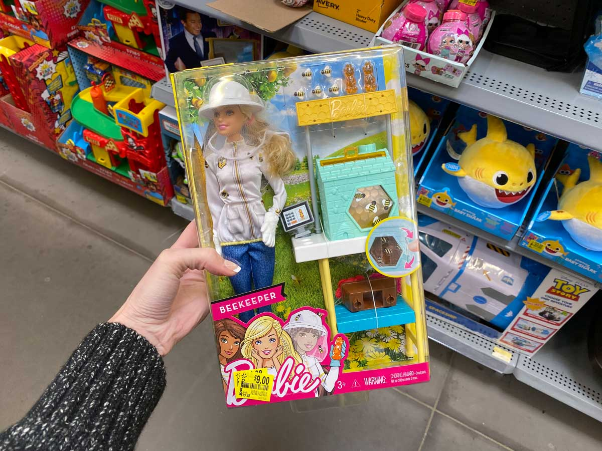 hand holding a Barbie Beekeeper doll