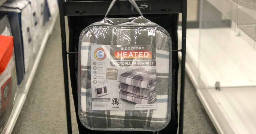 Biddeford brand heated blanket in package hanging from Kohl's shopping cart