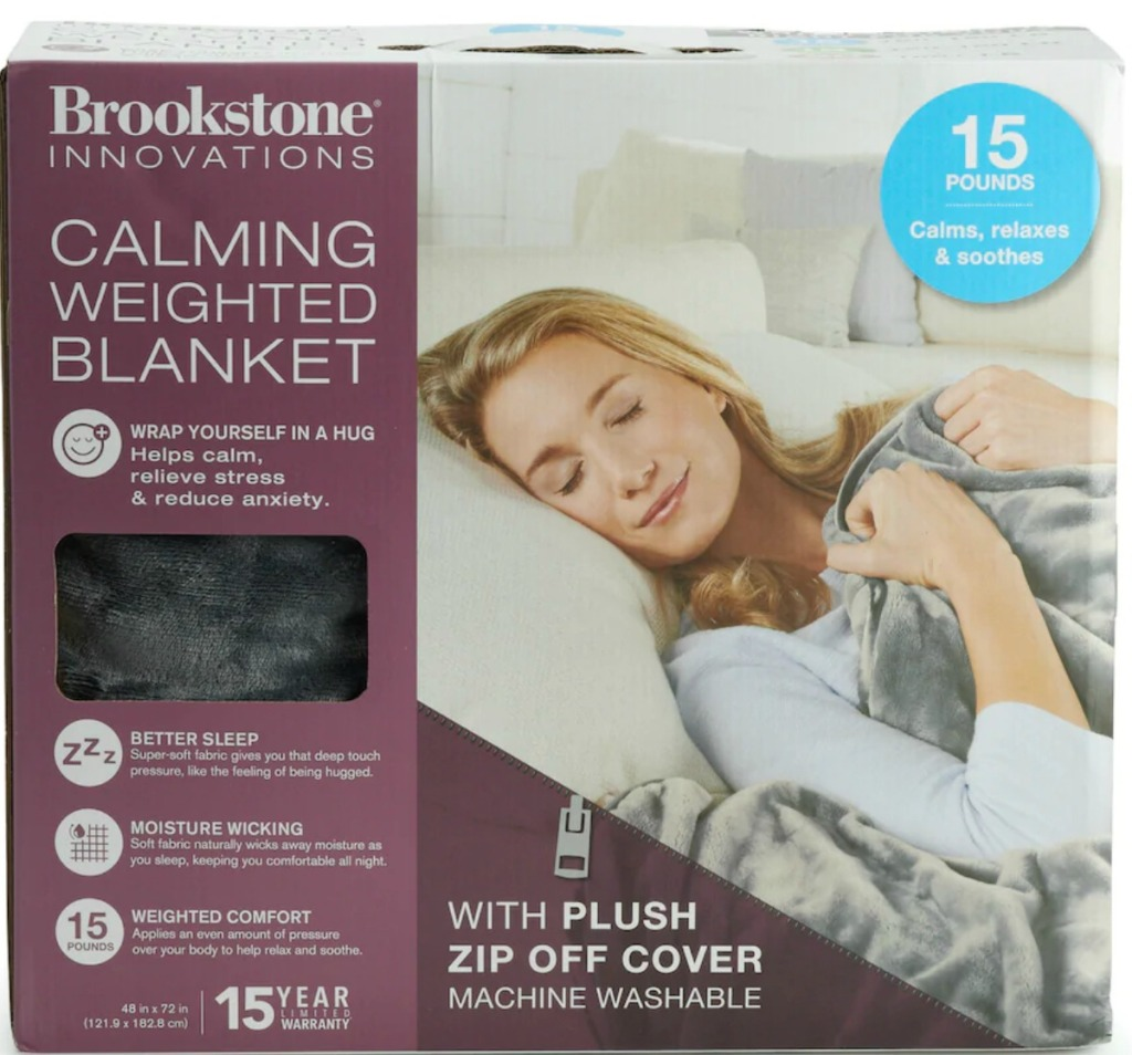 Weighted blanket in box with image of woman on cover