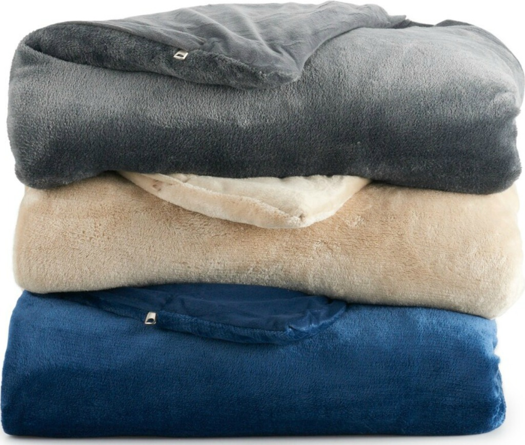 Stack of folded weighted blankets in three colors
