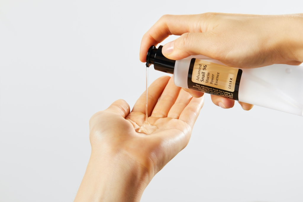 COSRX Advanced Snail 96 Mucin Power Essence being poured into hand