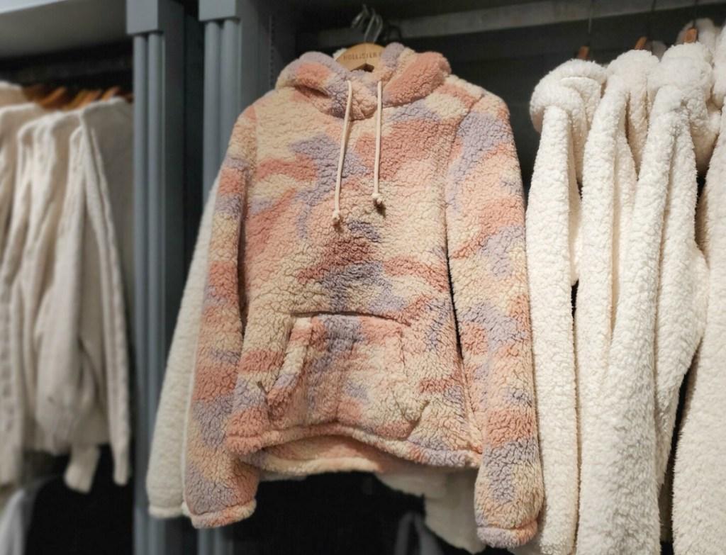 Pink camo sherap hoodie on rack in-store