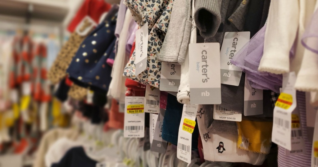 Carter's Clothes hanging on a rack with clearance tags