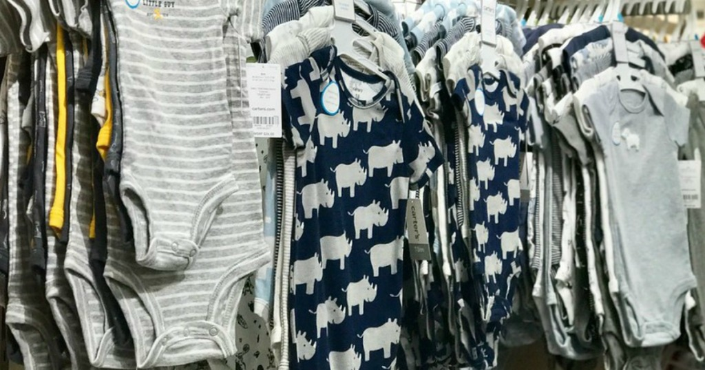 Carter's baby bodysuits hanging on the racks