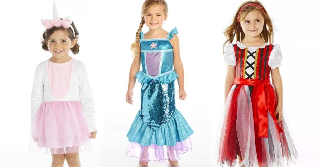 girls wearing halloween costumes