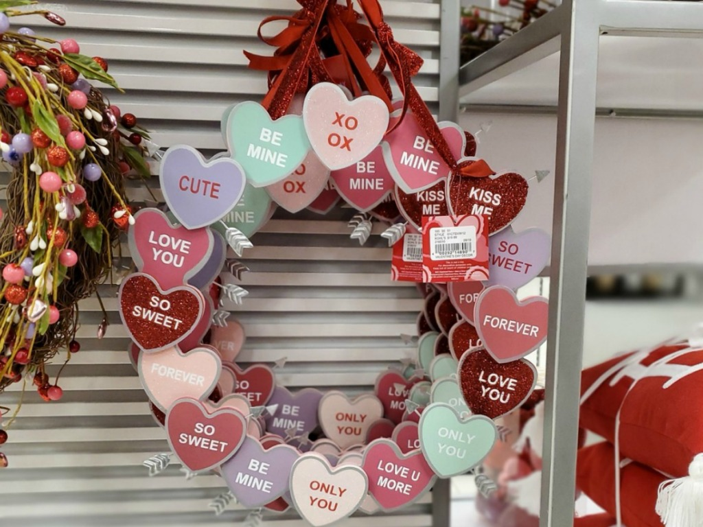 A conversation heart candy themed wreath on display in-store