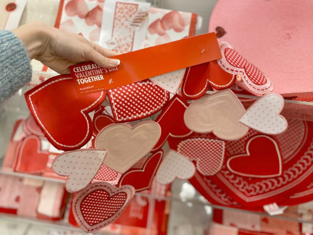 Cut-out heart themed placemat with tag on in-store in hand