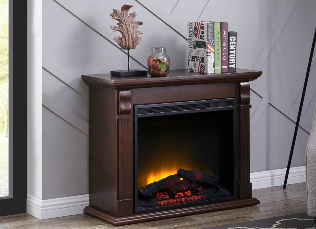 Chestnut colored wooden detailed fireplace in living room with decor on mantle