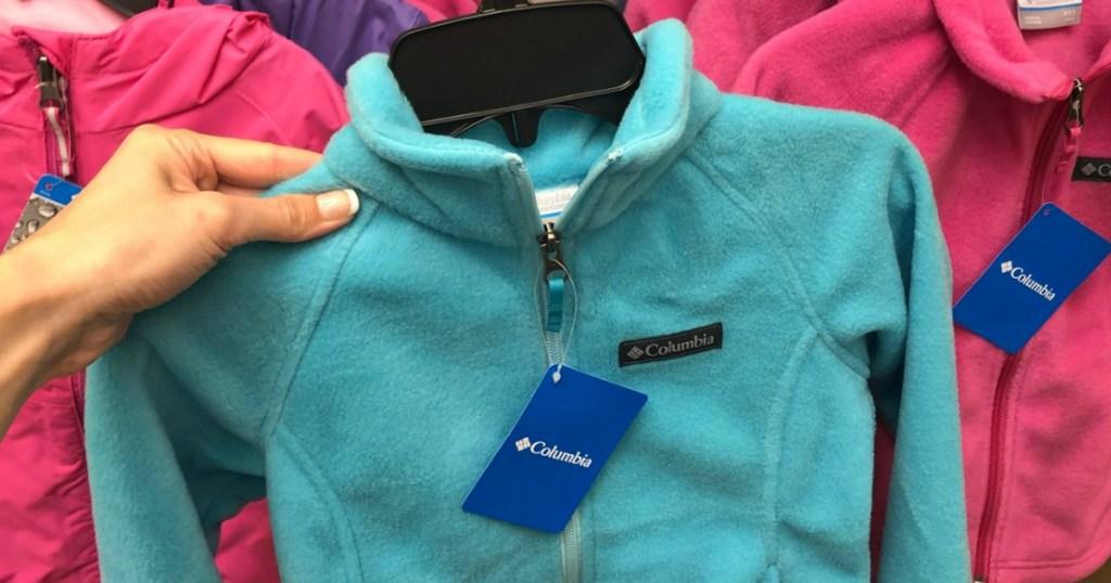 Sky blue fleece jacket on hanger in-store