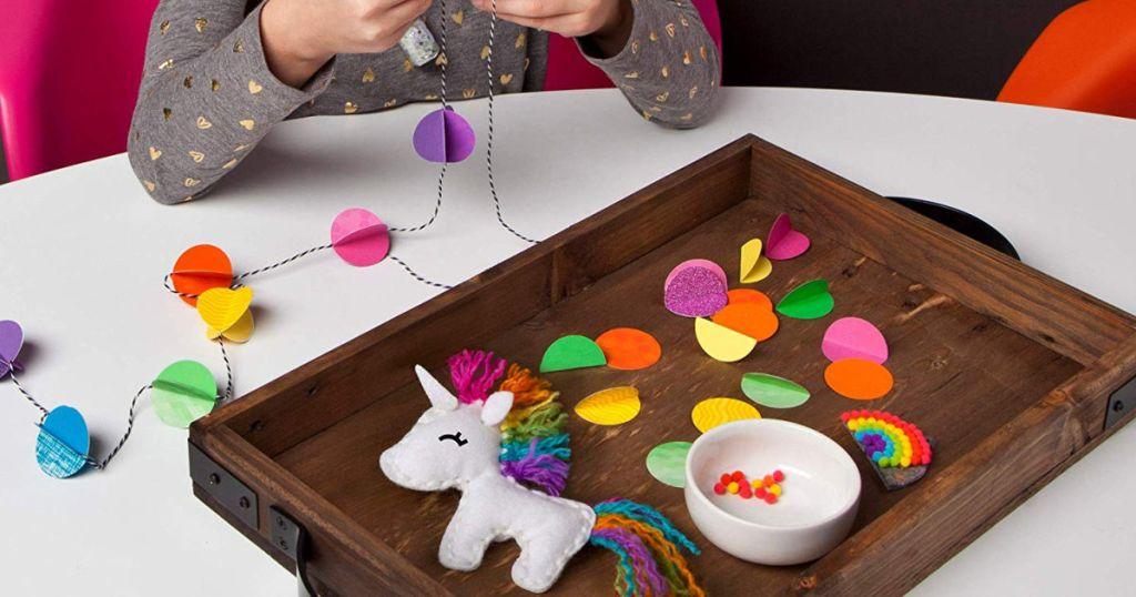 girl playing with Craft-tastic-I-Love-Unicorns-Kit