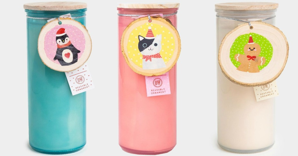 tall scented candles with illustrated animal tags on them