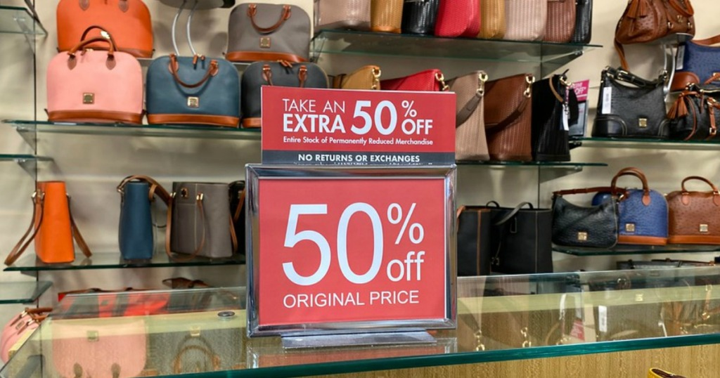 Dillard's new years sale with a 50% off sign