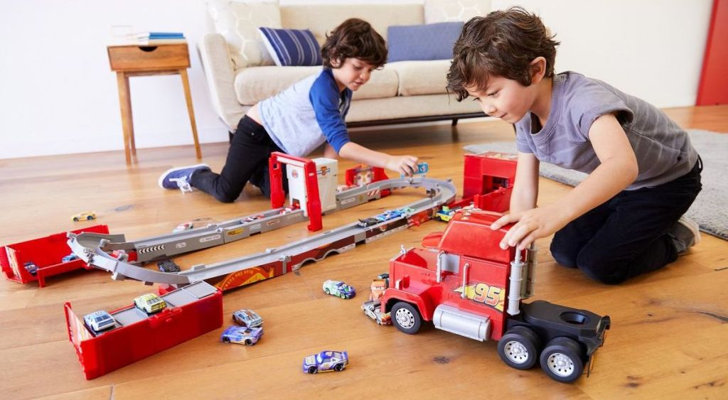 kids playing with a Disney Cars Mack Playset
