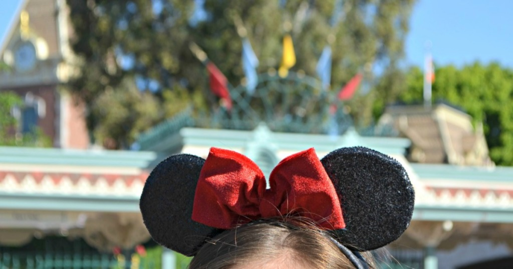 Girl wearing minnie mouse ears at Disney park