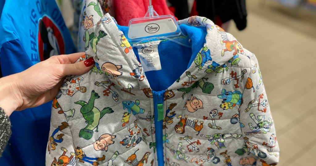 Woman holding Disney Toy Story Kids Jacket in JCPenney