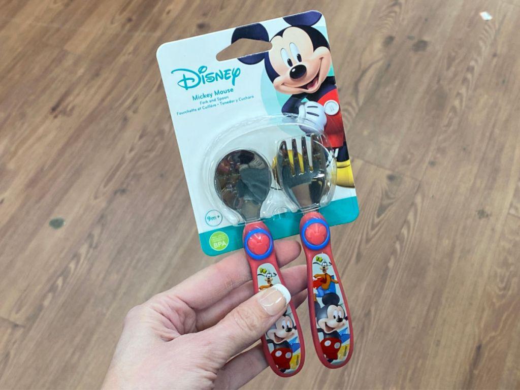 hand holding Disney Minnie Silver Ware Sets