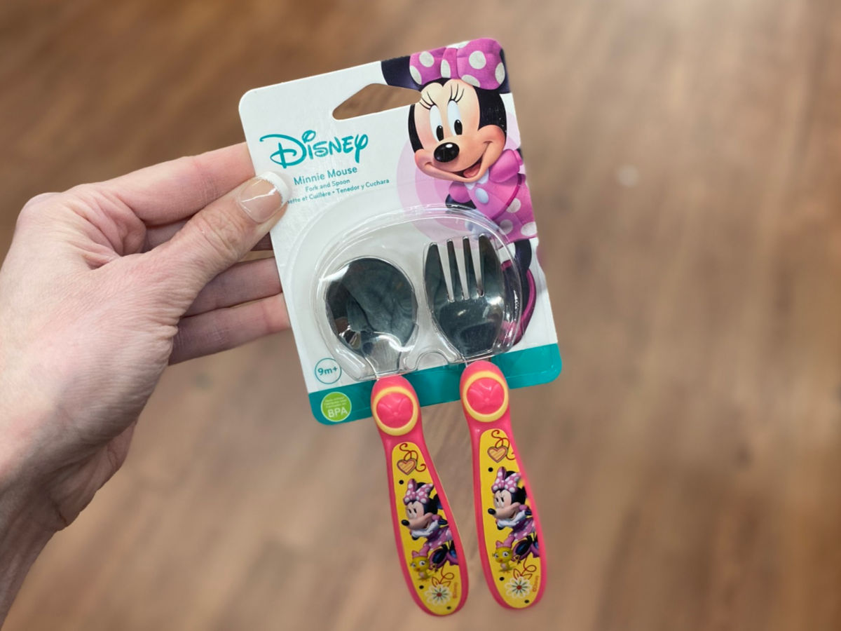 woman hand holding Disney Minnie Silver Ware Sets