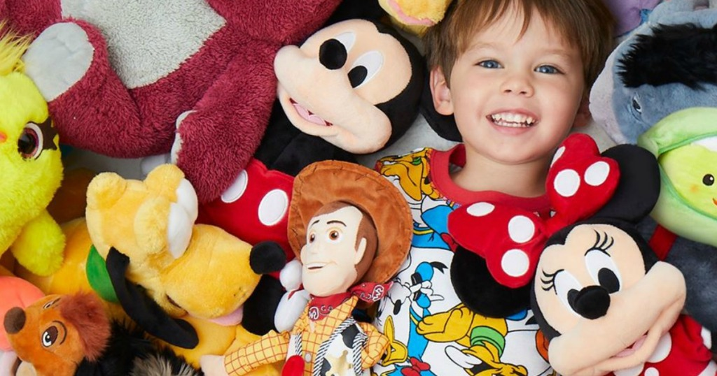 boy surrounded by Disney Plush
