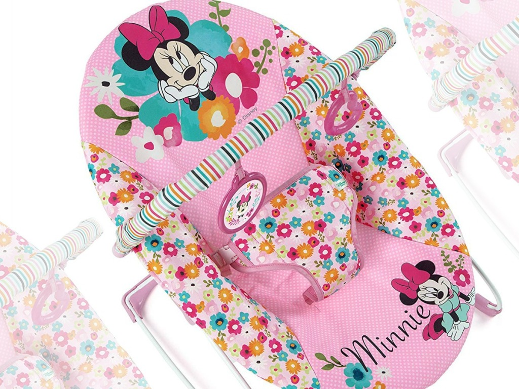 pink Minnie Mouse baby bouncer seat with toys attached to bar