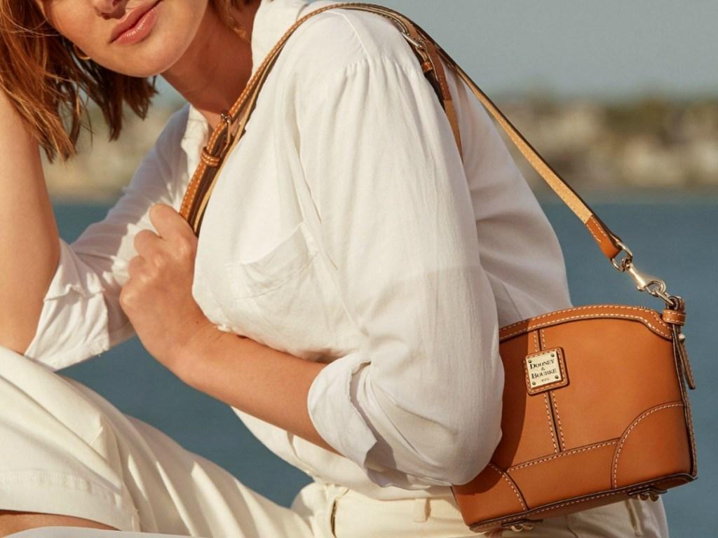 Women wearing Tan shoulder bag outdoors