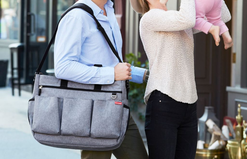 family outside with man with Duo Double Signature Diaper Bags