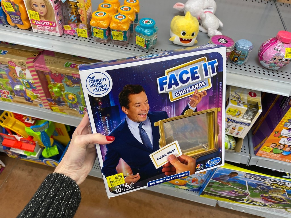 Woman's hand holding the Face It Challenge game in Walmart