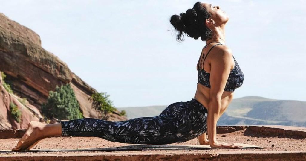 woman doing yoga wearing Gaiam Athletic Wear