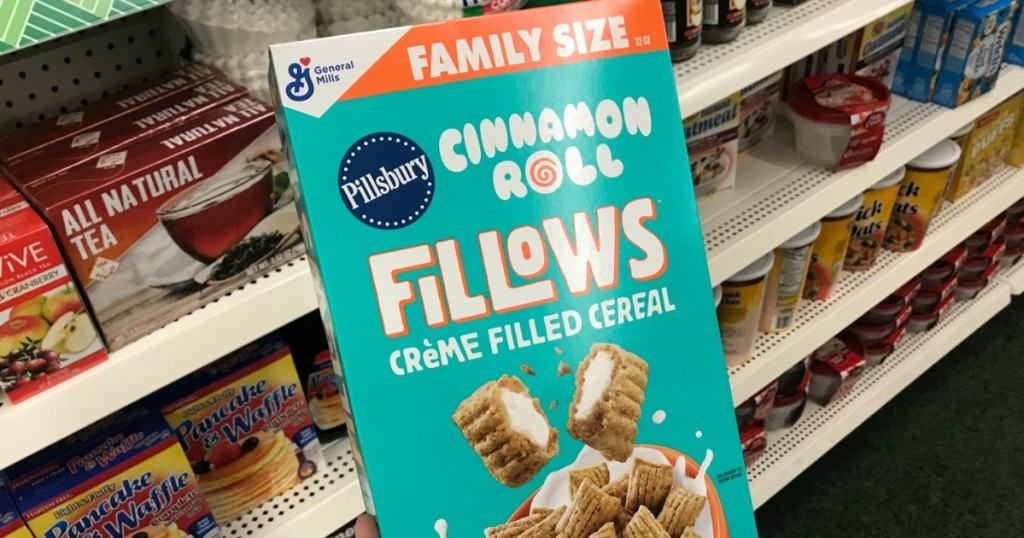 hand holding a box of Fillows cereal at Dollar Tree