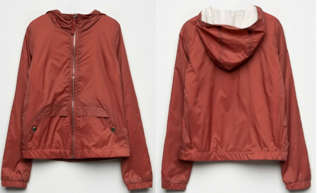 Two angles of girls windbreaker jacket in rust color