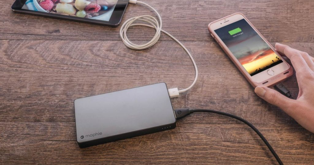 grey mophie powerbank charging iphone and ipad