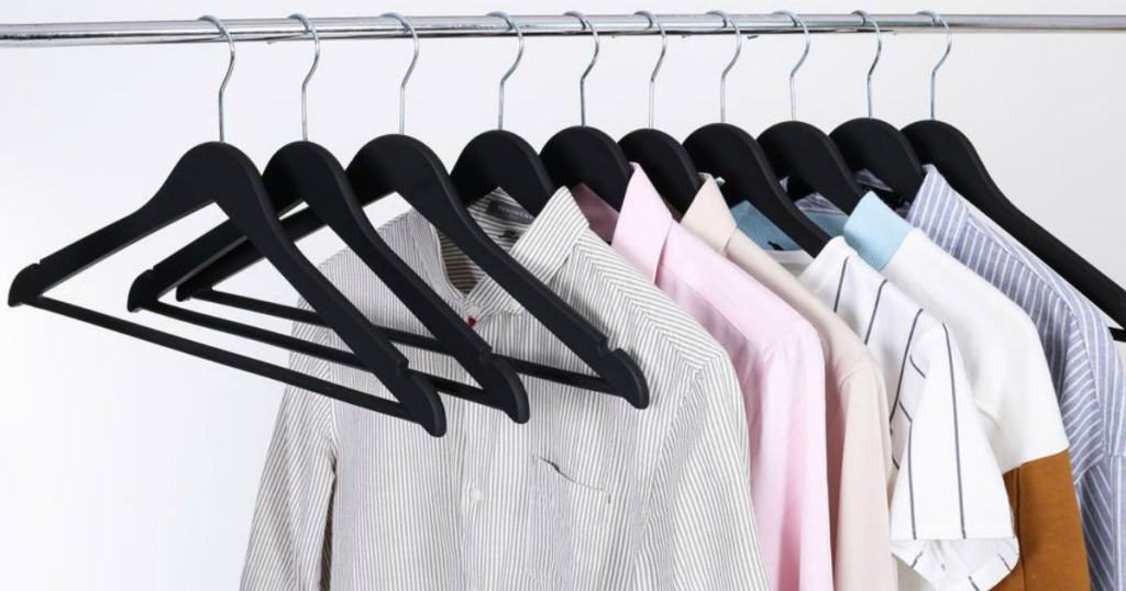 hangers on rack with clothes on hangers