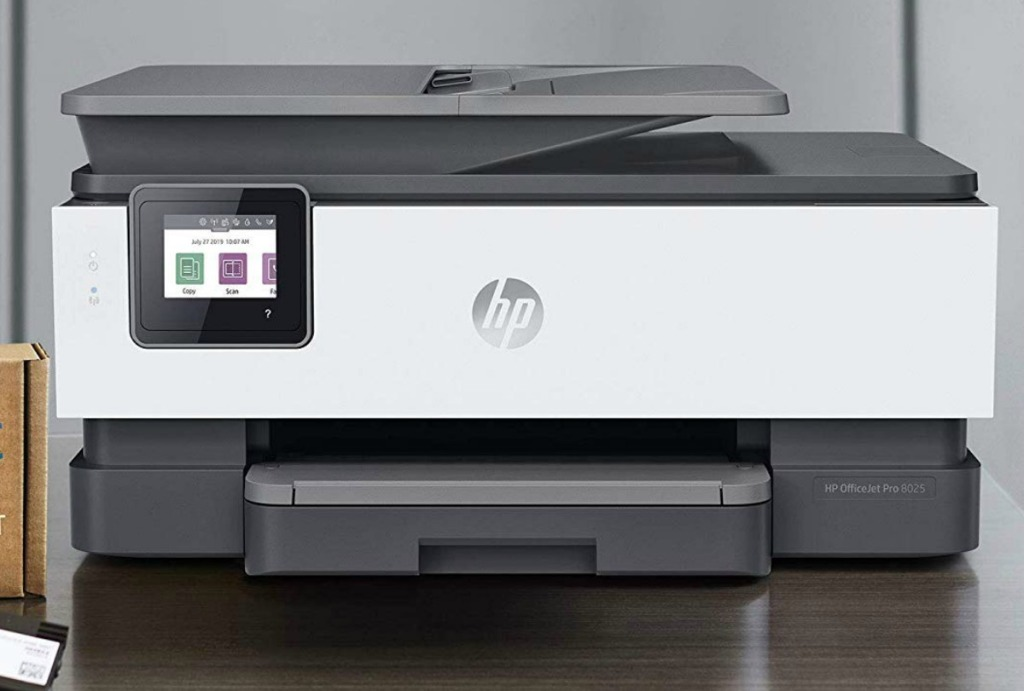 Smart printer with LCD display touch buttons in black and white on counter top