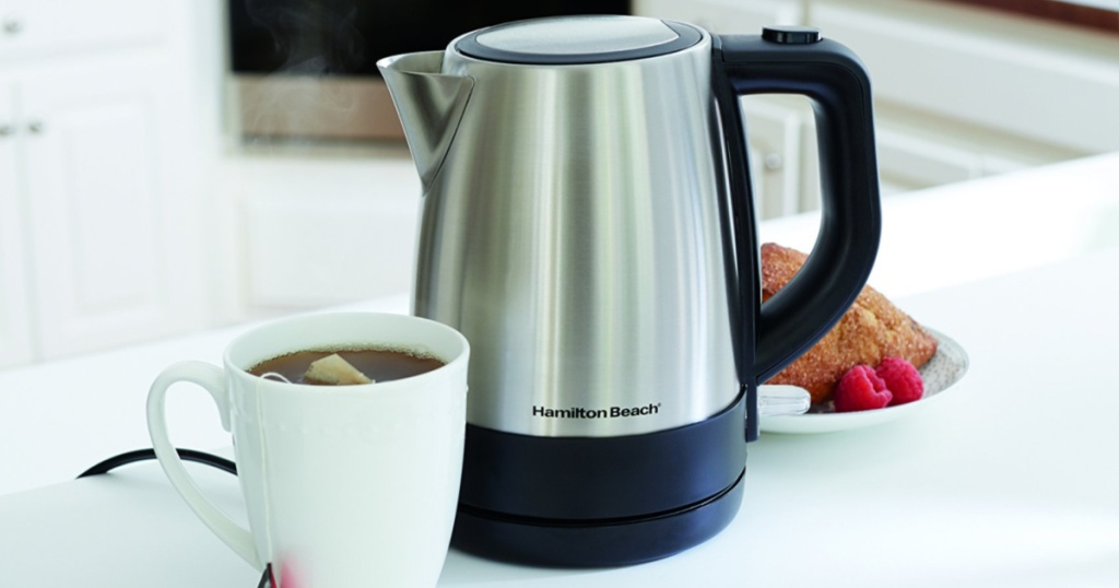 stainless steel hamilton beach kettle on counter with coffee and pastry on counter