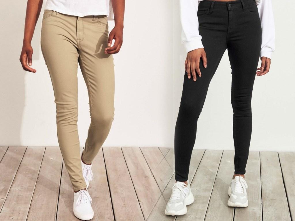 Two women wearing jeans - black and khaki
