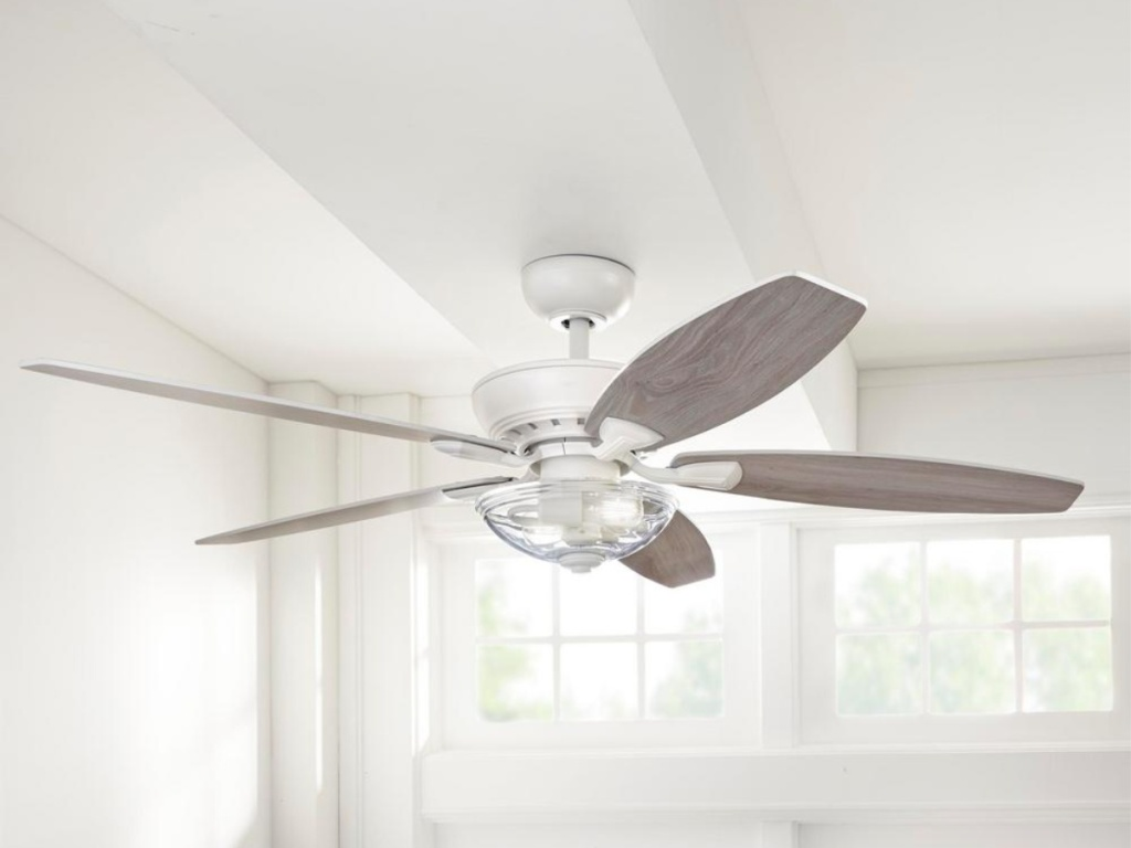 white ceiling fan with glass light hanging in living room