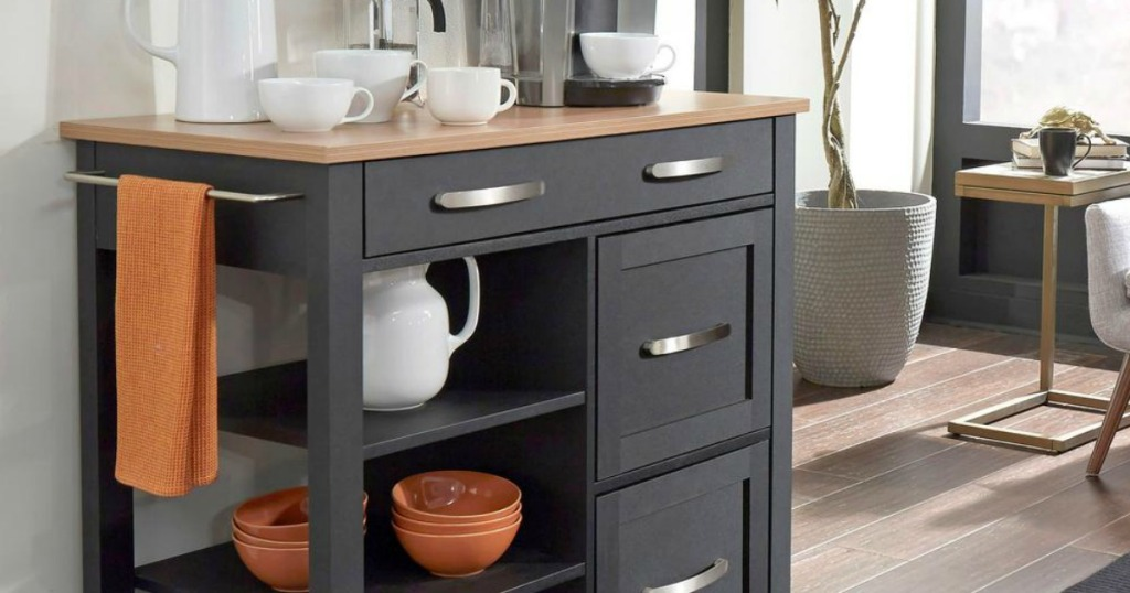 Black kitchen cart with coffee mugs and accessories