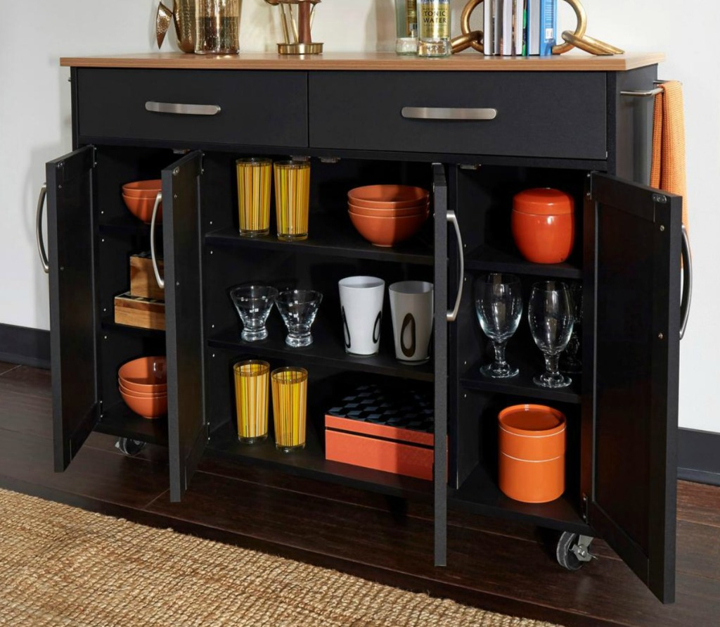 Extra wide kitchen cart with glasseware in the open cupboards