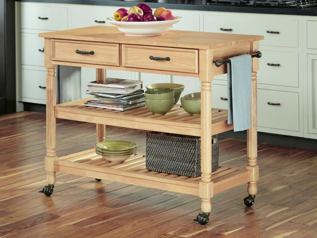 Maple finished kitchen storage cart with plates on shelving