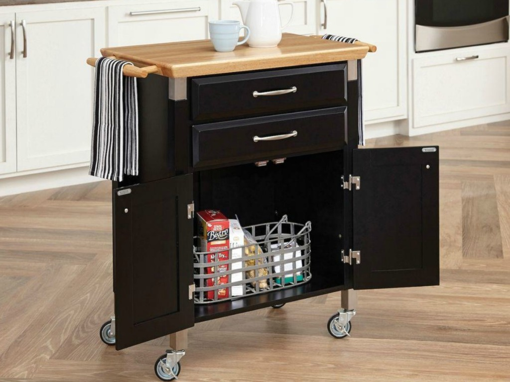 black kitchen cart with light wooden counter top and cupboard doors
