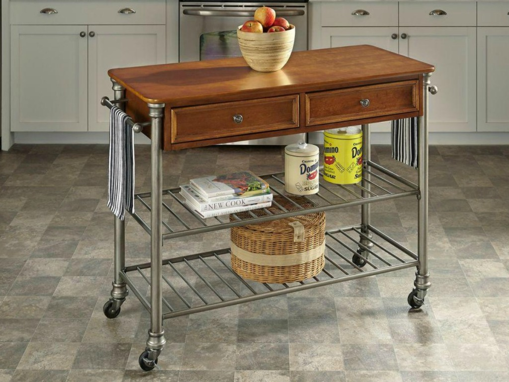 Wooden kitchen cart with metal shelving and built-in towel rack in tiled kitchen