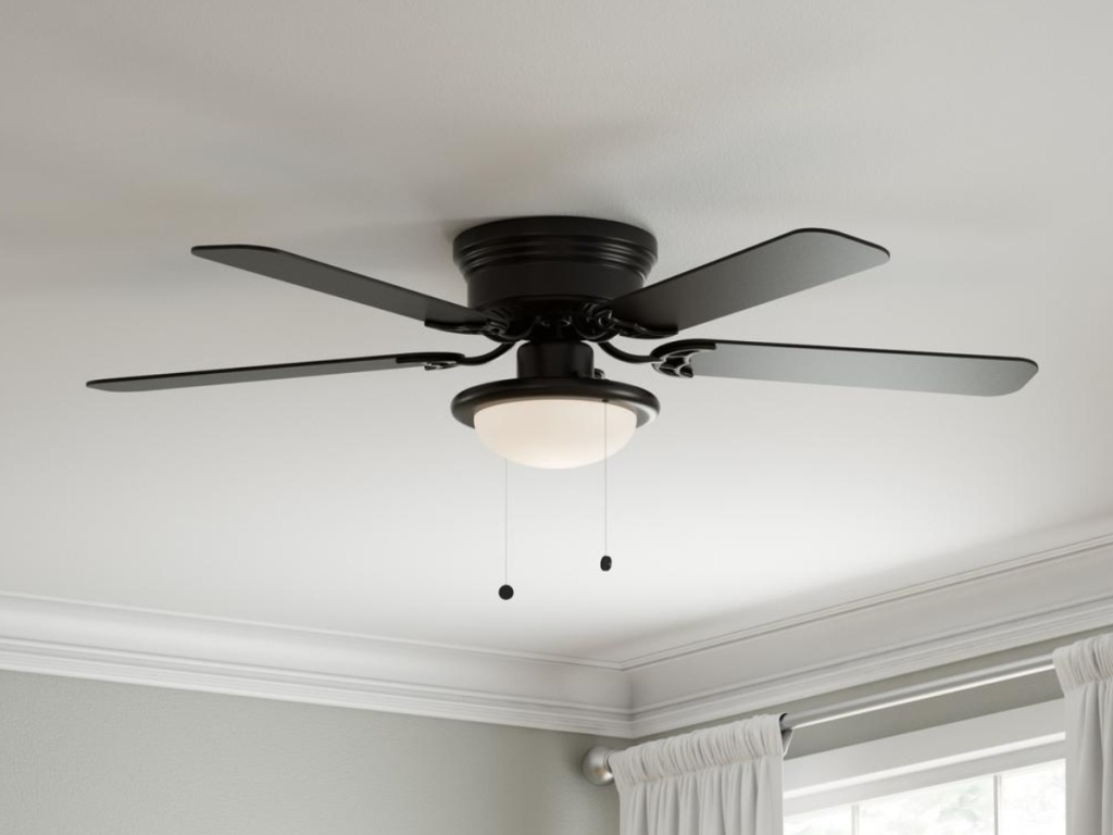 black ceiling fan with light and corns hanging from light