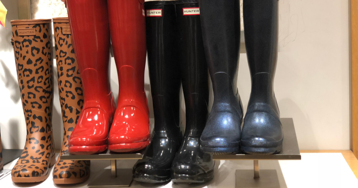 hunter leopard, red, black and blue glossy boots on display in store