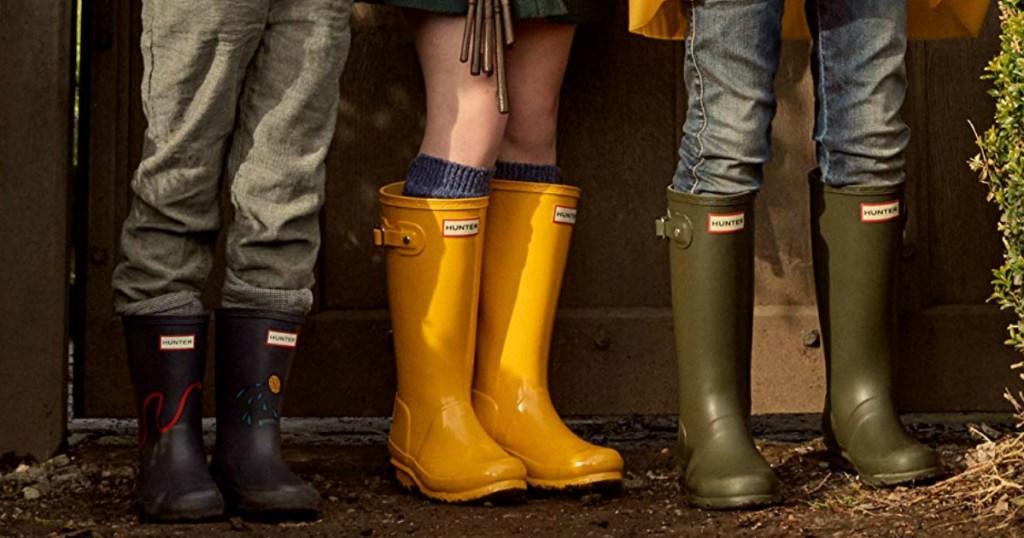three Kids wearing Hunter boots