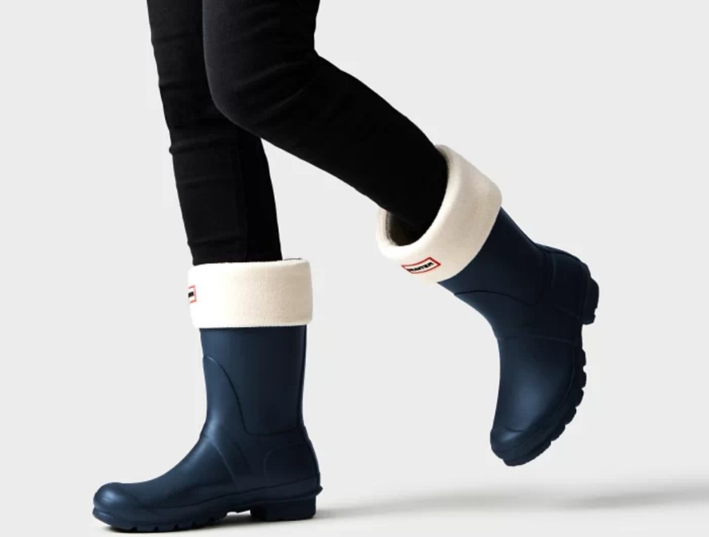 woman in black leggings and short rain boots with boot socks