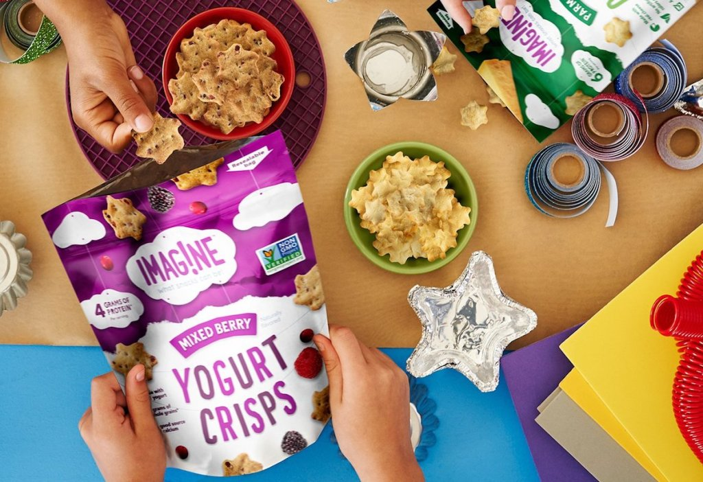 table with Imagine Yogurt Crisps and kids holding bag of crisps