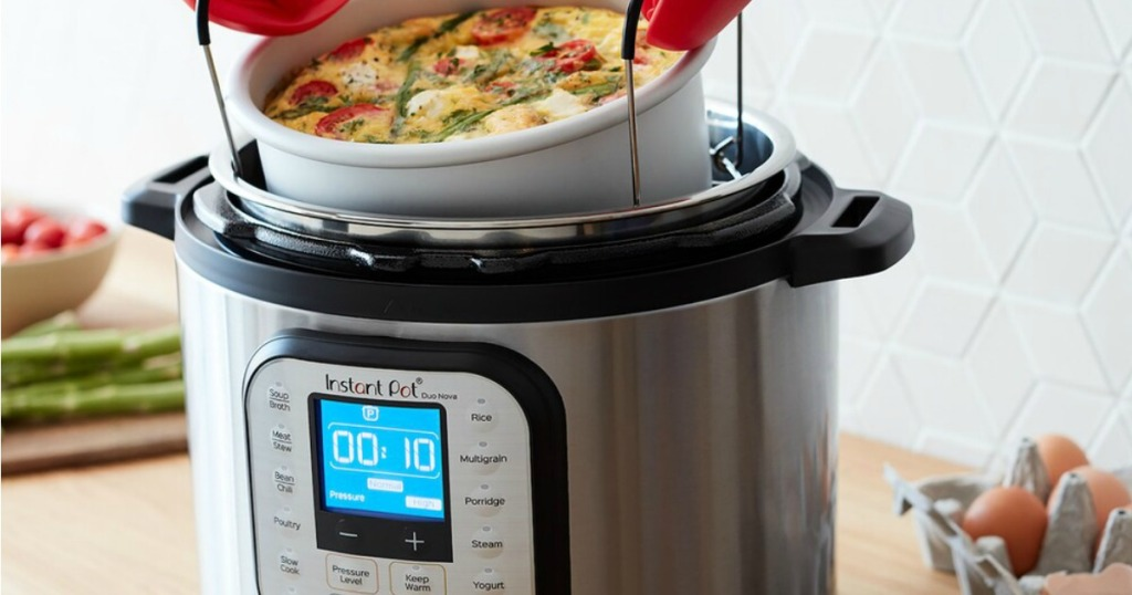 Instant Pot Duo Nova Pressure cooker with quiche dish being removed