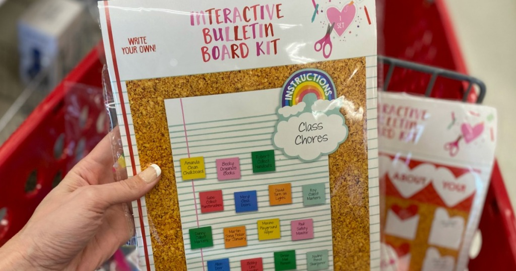 hand holding a Interactive Bulletin Board Kit in front of Target cart
