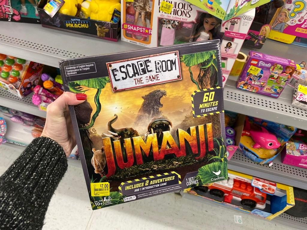 Hand holding Jumanji Escape Room